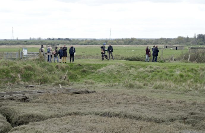 The image shows walkers in front of the old gunpowder works in Uplees near Faversham